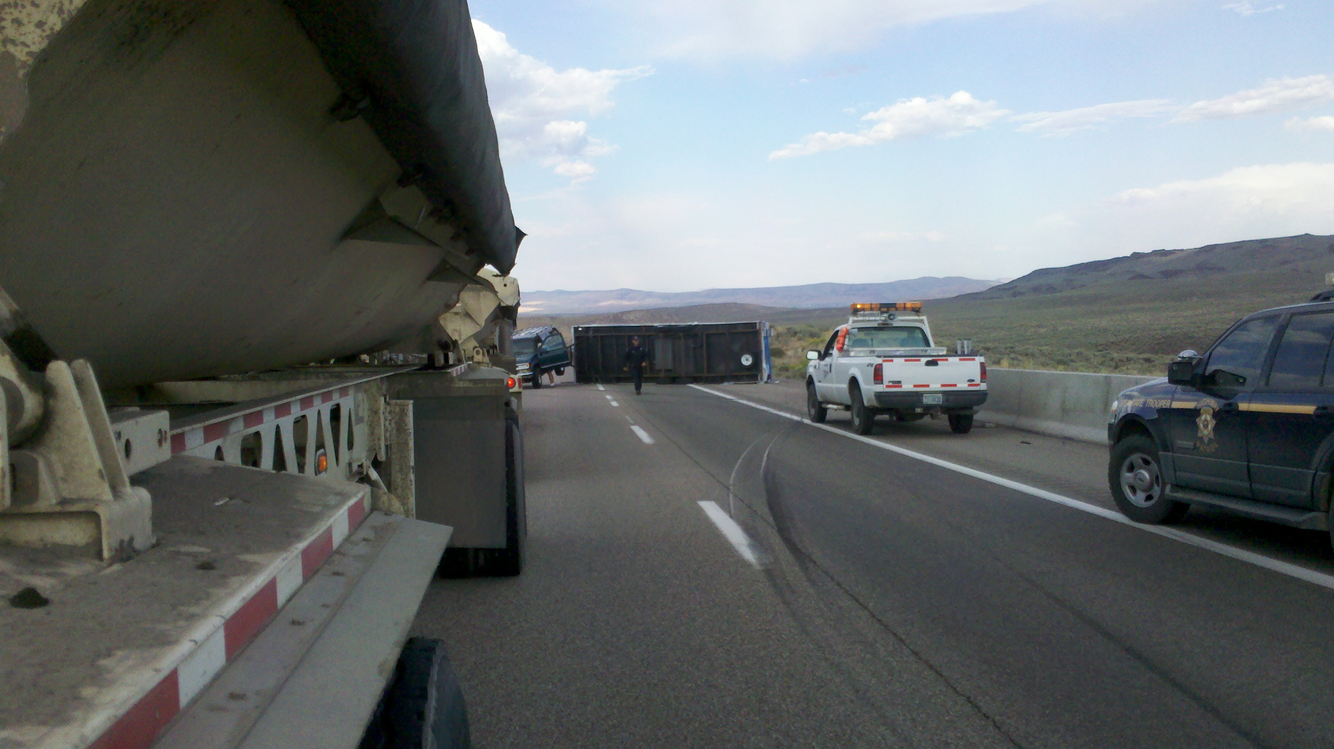 Travel Trailer on its side wast of Winnemucca NV on I80